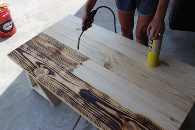 Picture Of charming vintage diy sawhorse coffee table  3