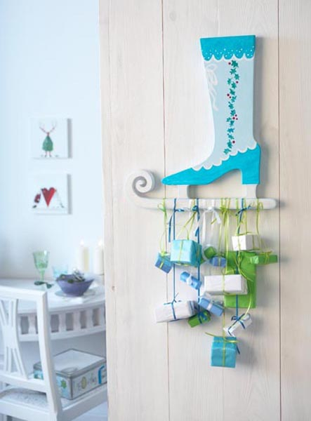 Here is a very cool and creative stocking alternative. It'd work great as wall decor  somewhere on a kitchen.