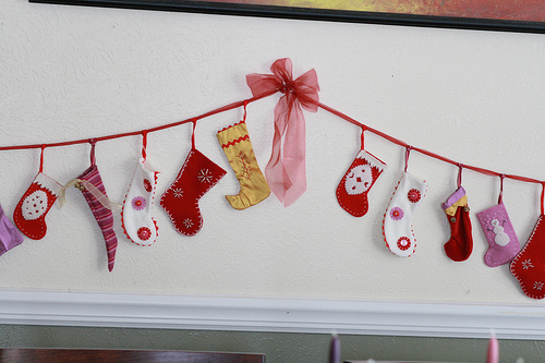 Cute little faux stockings are perfect to make a garland. You can hang it anywhere to add a splash of color to your decor.