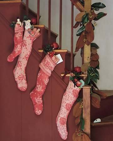 If you don't have a mantel, then a staircase is the next best thing you can hang Christmas stockings on.
