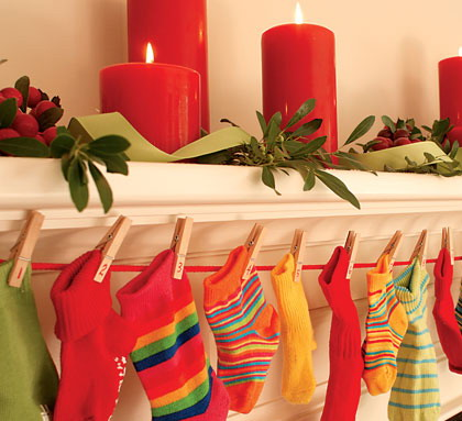 A collection of socks of your little ones in festive colors looks adorable along any mantle or railing.