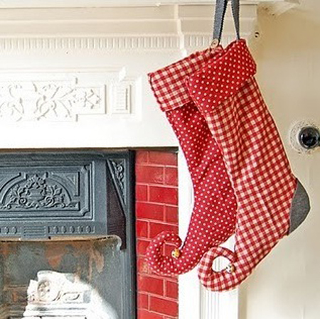 Beautifully-patterned stockings in unconventional shapes could make your Christmas decor much more cool and funky.