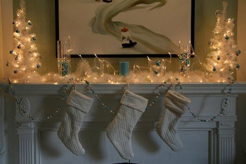 Add some Christmas lights on your mantel to highlight your stockings arrangement.