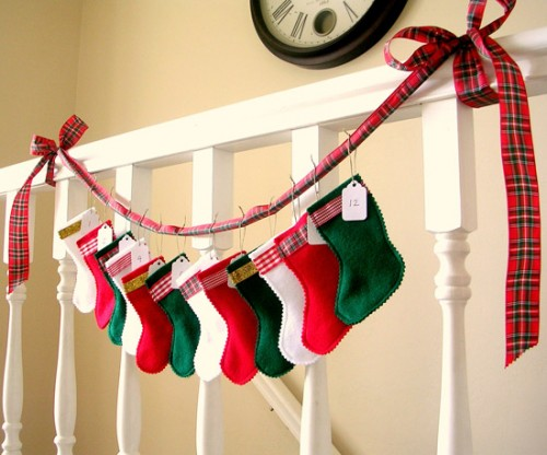 You can hang a stockings garland virtually anywhere. Staircase's railing is a quite obvious choice.
