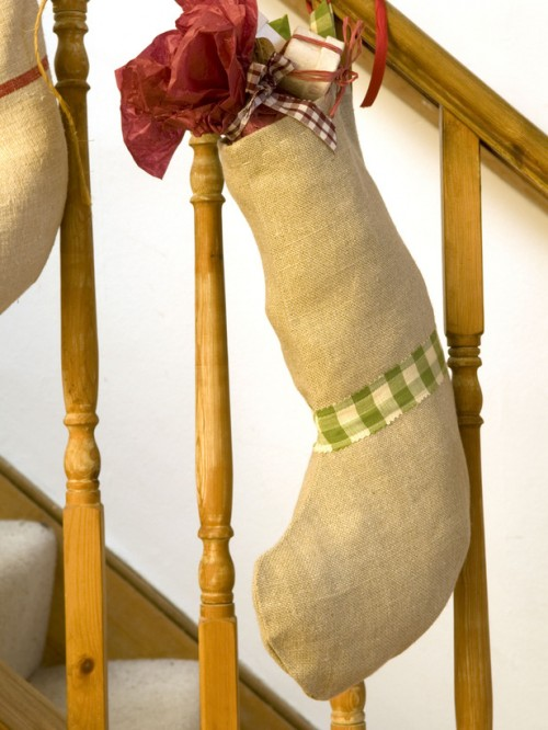Decorating with burlap is a great way to add some coziness to your decor for fall and winter. Why not to make Christmas stockings from this awesome material, right?