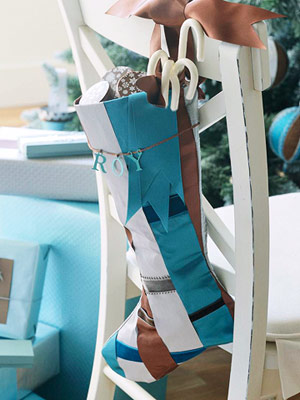 If you're preparing a festive table setting than hanging stockings on your guest's chairs is a great way to show them how important they are.
