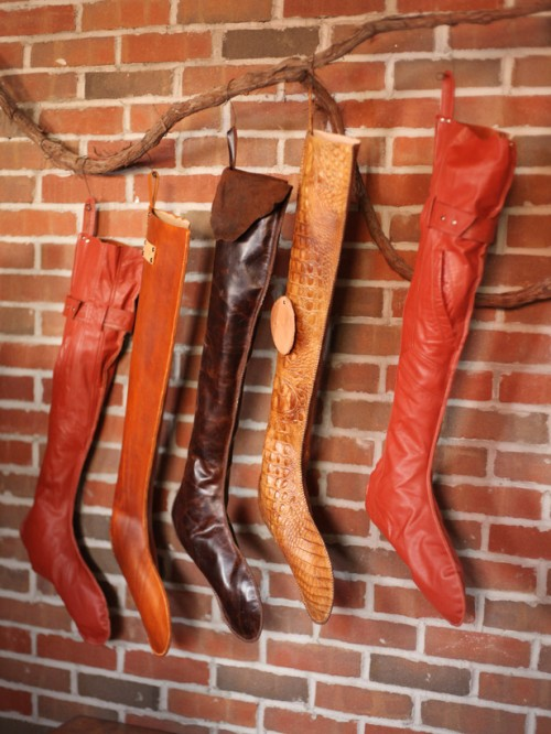 Leather stockings on a twig is a kinda unusual but cool solution for rustic settings.