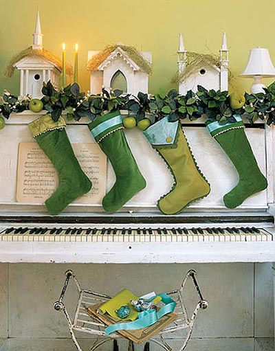 These felt socks, cut with scallop scissors is a great example of how you can mix and much similar colors for a more sophisticated mantel decor.