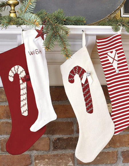 Decorate the stockings with candy cane appliques to make them even more desirable for your kids.