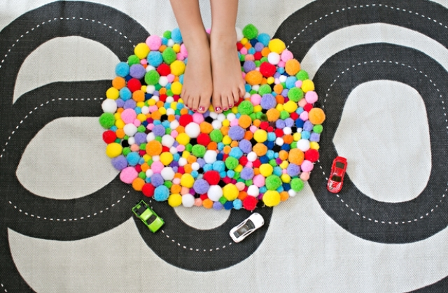 Picture Of colorful and easy diy pompom rug  1