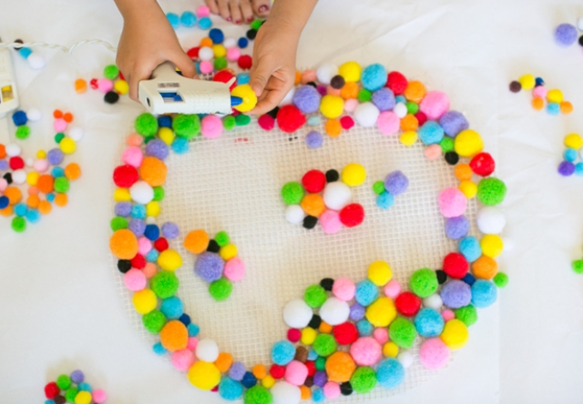 Picture Of colorful and easy diy pompom rug  4