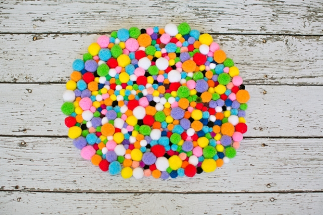 Picture Of colorful and easy diy pompom rug  5