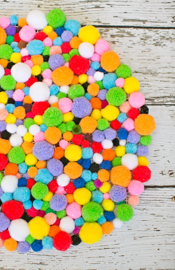 Picture Of colorful and easy diy pompom rug  6