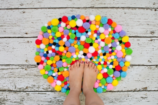 Picture Of colorful and easy diy pompom rug  8