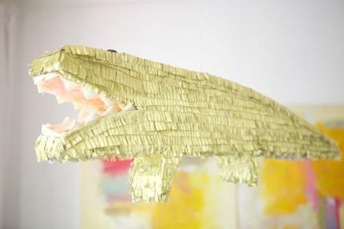 golden alligator pinata (via ohhappyday)