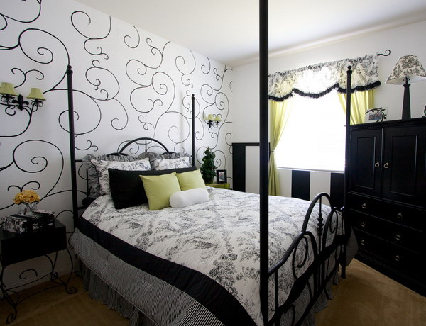 graphic black and white patterned wallpaper matches the monochromatic bedroom and bright yellow touches