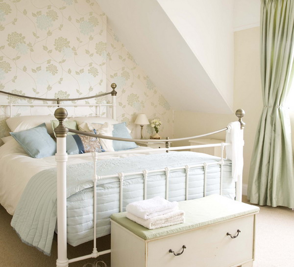 a neutral bedroom with a subtle floral accent wall, matching curtains and printed bedding