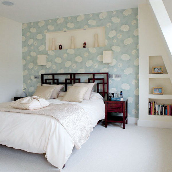 a neutral bedroom with a blue printed headboard wall that brings in a touch of color and pattern to the space
