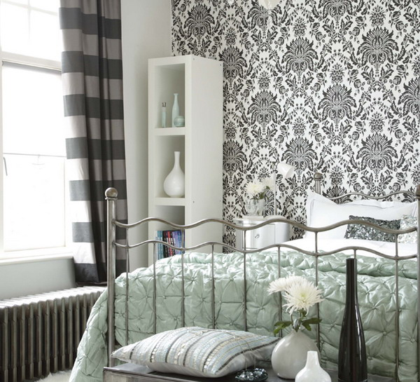a monochromatic room with a printed wallpaper wall that matches the color scheme and brings interest to the space