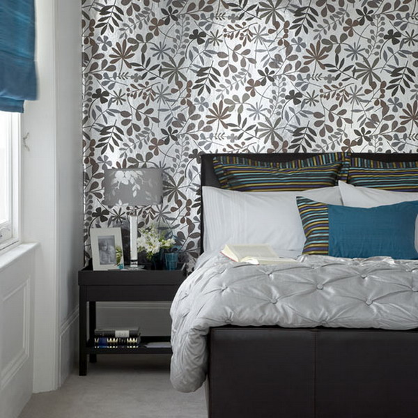 a stylish bedroom with a botanical accent wall that makes it catchier and bolder at once