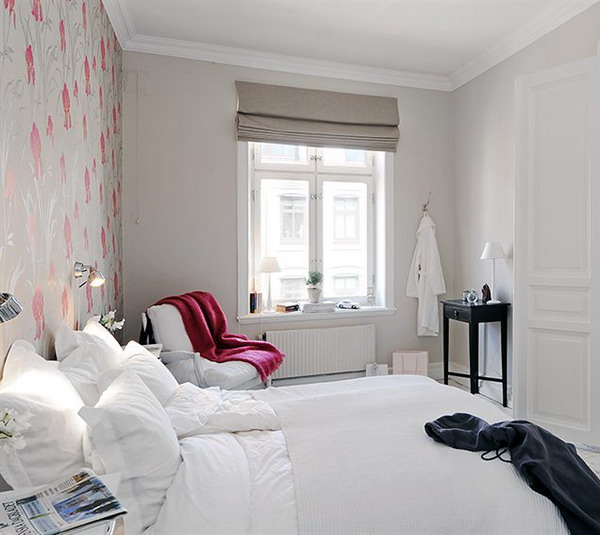 a dreamy white bedroom with a colorful accent wall and a matching blanket is a very cool and fun idea