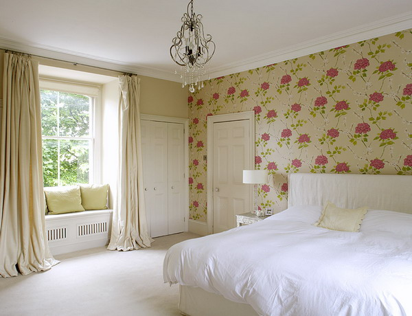 a chic bedroom with a floral wallpaper wall and matching textiles to make it chic and stylish