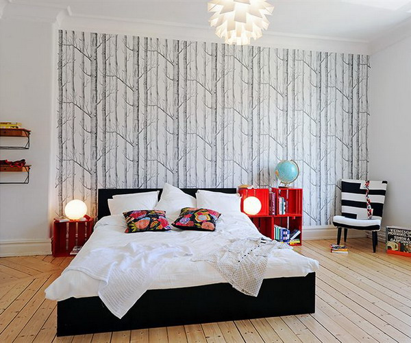 a neutral bedroom with a black and white printed wallpaper wall that adds catchiness to the space