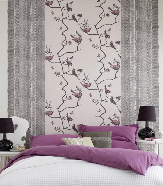 a bright and fun bird print wallpaper as an accent for the headboard wall and matching purple bedding