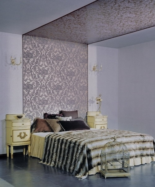 a lavender bedroom with a purple printed accent wall that goes up to the ceiling for eye-catchiness
