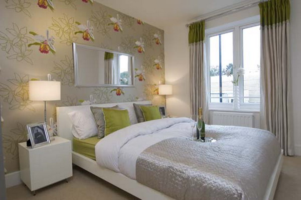 a light grey bedroom with a floral wall and matching bedding to give a lively look and a fresh feel to the room