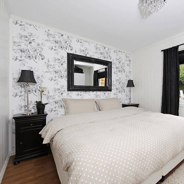 a monochromatic bedroom made much more interesting and eye catchy with a botanical print wall