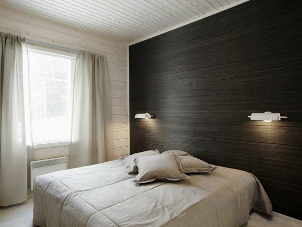 an accent wall covered with dark wallpaper reminding of wood grain is a veyr fresh and unusual solution