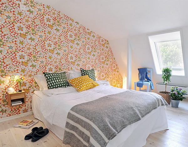 a quirky floral wallpaper wall brings color and pattern to the neutral space and makes it more cheerful
