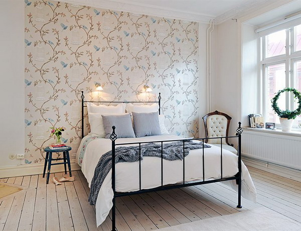 a neutral bedroom with a floral accent wall that brings in pattern and makes the space interesting and catchy