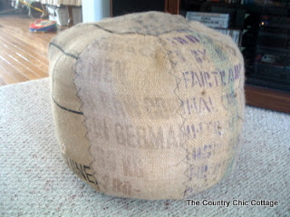 Burlap is perfect material for a homemade ottoman. (via thecountrychiccottage)