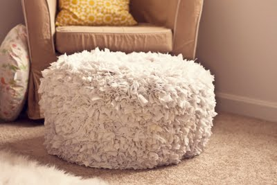 Fluffy things always looks cozy. The fabric here is attached using a hot glue gun.