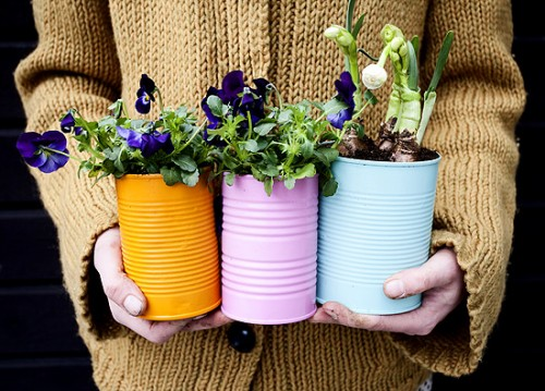 perforated tin cans as vases (via dosfamily)