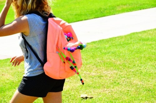 pompom backpack (via mrkate)