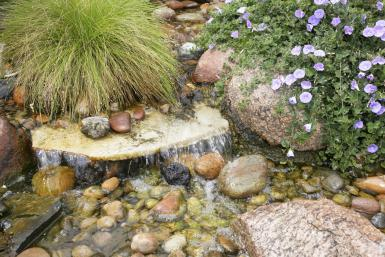 outdoor waterfall (via landscaping)