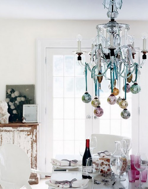Ornaments hanging from a chandelier instead of a tree