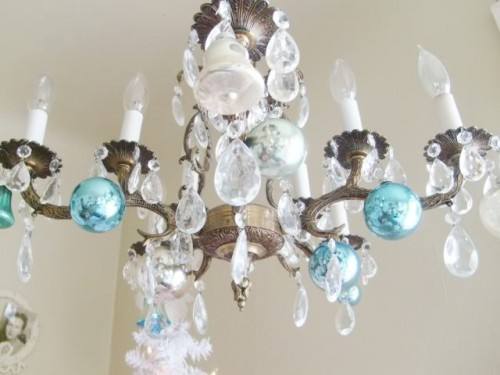 Chandelier with a few Christmas ornaments (via vintagebellastudio)
