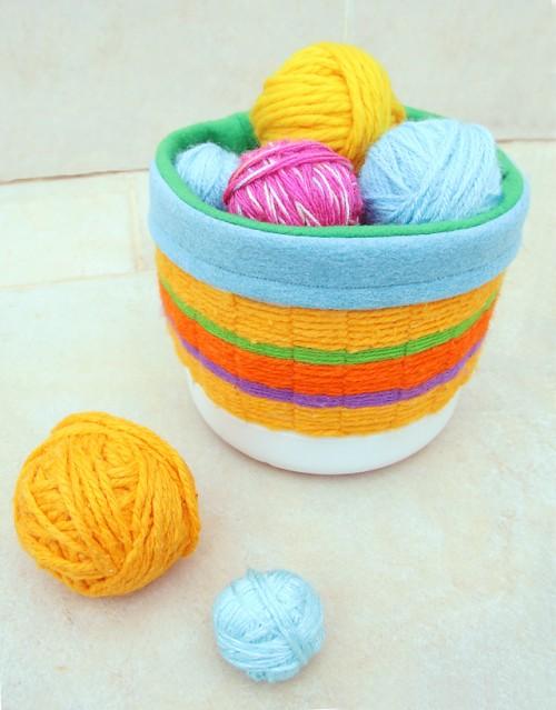 colorful yarn woven basket (via shelterness)