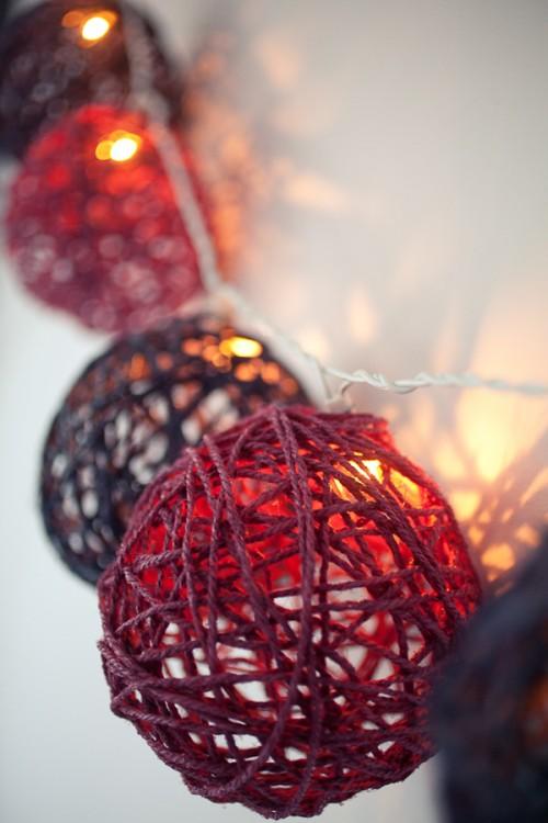 colorful yarn balls garland (via shelterness)
