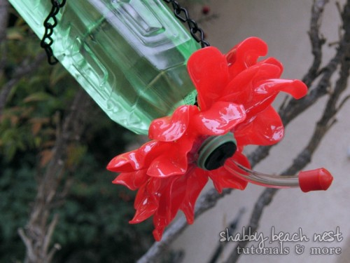hummingbird feeder of recycled materials (via shelterness)