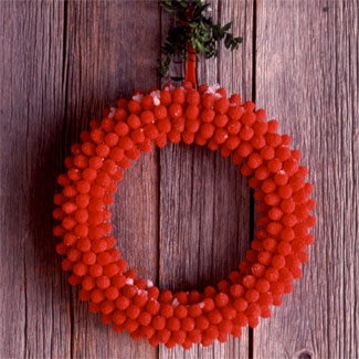 DIY Raspberry Candy Christmas Wreath (via goodhousekeeping)