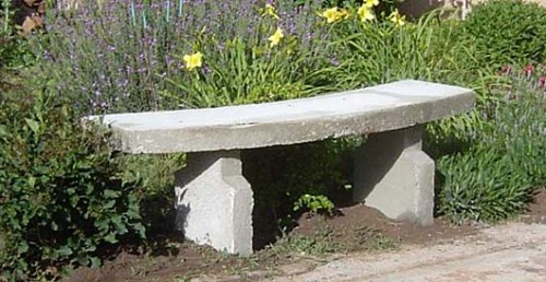 classic garden bench of concrete (via traditionaloven)