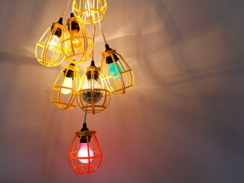 industrial light of bulbs and bird cages (via shelterness)
