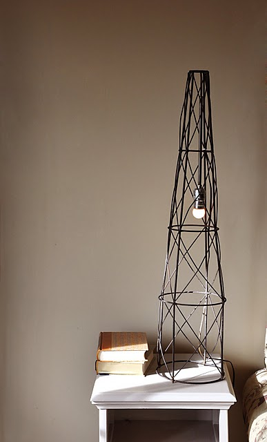 industrial lamp of a tomato cage (via shelterness)