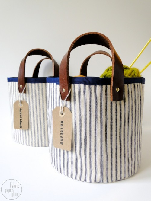 fabric and leather storage baskets (via fabricpaperglue)