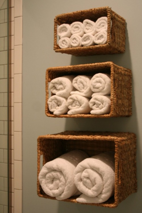 wall baskets for linen (via shelterness)